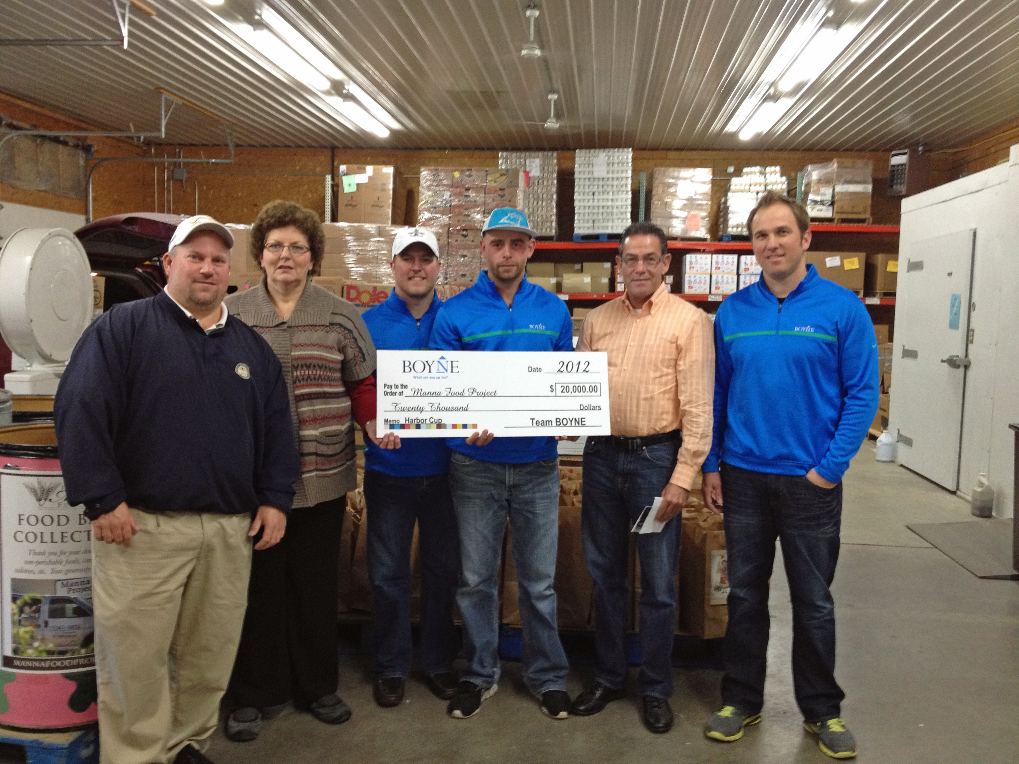 team boyne presents 20k to manna food project mike fay